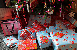 File photo dated 20/12/2016 of presents wrapped and under a Christmas tree. Around eight million Britons are likely to be entering January with a spending hangover from Christmas, research suggests.