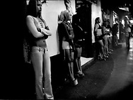 """Paraditas, """"Standing Girls"""", wait for male customers outside brothels lining street in the Coahuila District, Zona Norte, Tijuana, Mexico.    Paraditas are sex workers who may legally ply their trade in Zona Norte, less than 500 m from the Mexican / US border."""