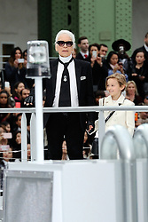 File photo - Karl Lagerfeld and Hudson Kroenig walk on the runway during the Chanel show during Paris Fashion Week Ready to wear FallWinter 2017-18 on March 07, 2017 in Paris, France. Karl Lagerfeld died on Monday at age 85. One who may inherit is his godson Hudson. Hudson's dad, model Brad Kroenig, is like 'family' to Lagerfeld. Hudson began modeling for Chanel at age two and had continued to pop up on the runway ever since. Photo by Aurore Marechal/ABACAPRESS.COM