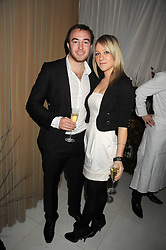 CHLOE MADELEY and DAVID McNIDDER at a reception before the launch of the English National Ballet Christmas season launch of The Nutcracker held at the St,Martins Lane Hotel, London on 5th December 2008.