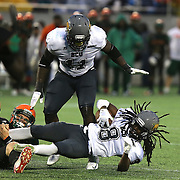 Bethune Cookman cornerback Thomas Finnie (8) gets tackled after recovering a turnover during the Florida Classic NCAA football game between the FAMU Rattlers and the Bethune Cookman Wildcats at the Florida Citrus bowl on Saturday, November 22, 2014 in Orlando, Florida. (AP Photo/Alex Menendez)