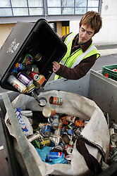 Man recycling steel and aluminium cans for Emerge Recycling; Manchester,