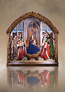 """Gothic painted Panel Virgin of the """"Consellers"""" by Lluis Dalmau. Tempera and gold leaf on wood. Date 1443-1445. Dimesions 316 x 312.5 x 32.5 cm. From the altar of the chapel of Barcelona City Hall. <br /> The prestige attached to Burgundian courtly culture and the painter Jan van Eyck explain why in 1431 King Alfons the Magnanimous sent his official painter, the Valencian Lluís Dalmau, to Flanders, to learn the new realist language at first hand. In 1443, Dalmau was commissioned to paint this altarpiece for the chapel of the City Hall. This work was a breakthrough in Catalonia on account of the format, the technique used, as it was painted in oil, and the skilful illusionism of a figurative space in which that year's five councillors, painted from life, are represented on the same scale as the Virgin and the Saints. National Museum of Catalan Art, Barcelona, Spain, inv no: 015938-000 .<br /> <br /> If you prefer you can also buy from our ALAMY PHOTO LIBRARY  Collection visit : https://www.alamy.com/portfolio/paul-williams-funkystock/romanesque-art-antiquities.html<br /> Type -     MNAC     - into the LOWER SEARCH WITHIN GALLERY box. Refine search by adding background colour, place, subject etc<br /> <br /> Visit our ROMANESQUE ART PHOTO COLLECTION for more   photos  to download or buy as prints https://funkystock.photoshelter.com/gallery-collection/Medieval-Romanesque-Art-Antiquities-Historic-Sites-Pictures-Images-of/C0000uYGQT94tY_Y"""