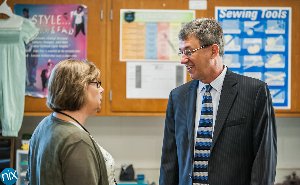 Cabarrus County Schools superintendent Dr. Barry Shepherd talks with teacher Susan Sloop during a tour at Northwest Cabarrus High School Monday morning.