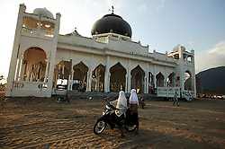 The mosque at  Lampuuk which was hit badly by the enormous tsunami wave of Dec 26th.  The community here has decided to stay and rebuild as soon as possible. A number of agencies have decided to help this community to get started. Near Banda Aceh.