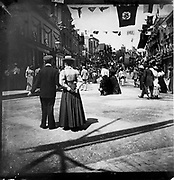 People gathering for a patriotic event with bunting flags across the street, possibly Edinburgh, Scotland, end of Boer War 1902