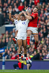 England Outside Centre Jonathan Joseph, Winger Anthony Watson and Wales Fly-Half Dan Biggar compete in the air for a high ball - Mandatory byline: Rogan Thomson/JMP - 12/03/2016 - RUGBY UNION - Twickenham Stadium - London, England - England v Wales - RBS 6 Nations 2016.