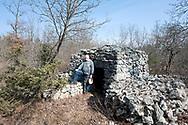 Dušan Luin in front of the traditional dry stone shepherd's hut he helped restore, near the village of Kosovelje, Kras (Karst) region, Slovenia © Rudolf Abraham