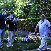 Punters study form near the parade ring during the 146th Running of the Belmont Stakes, Belmont  Park, Elmont. New York.  USA. 7th June 2014. Photo Tim Clayton