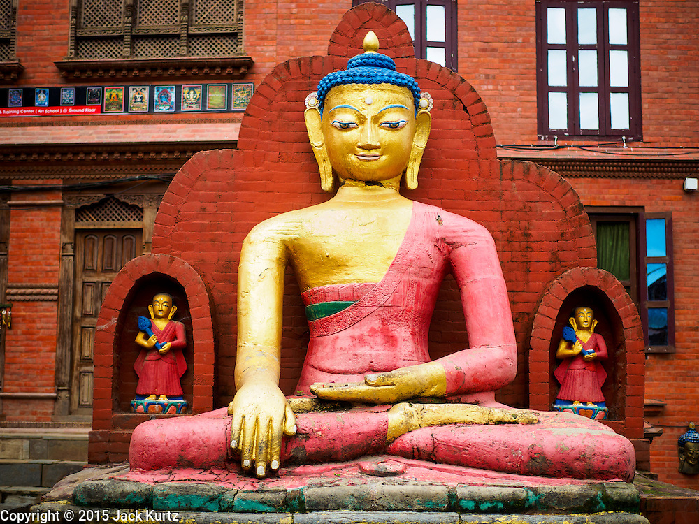 31 JULY 2015 - KATHMANDU, NEPAL:  A statue of a seated Buddha at Swayambhunath Stupa, a large Buddhist stupa in Kathmandu. Parts of the stupa were badly damaged in the Nepal earthquake of 2015 but it is still open for religious devotees and tourists. Construction of the stupa started in the 1600s.  PHOTO BY JACK KURTZ