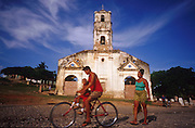 23 JULY 2002 - TRINIDAD, SANCTI SPIRITUS, CUBA: People go past Santa Ana Church a closed church in Plaza Santa Ana in the colonial city of Trinidad, province of Sancti Spiritus, Cuba, July 23, 2002. Trinidad is one of the oldest cities in Cuba and was founded in 1514. .PHOTO BY JACK KURTZ