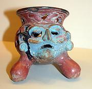 Pottery Tripod (Incense burner), Islas de Sacrificios, 900-1521 AD. The face of the Fire God (Aztec pantheon) Huehueteotl. The blue colour represents Tlaloc the Rain God.