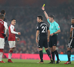 02 December 2017 London : Premier League Football : Arsenal v Manchester United - referee Andre Marriner showed a yeloow card to Alexis Sanchez of Arsenal and Ander Herrera of United.<br /> (photo by Mark Leech)