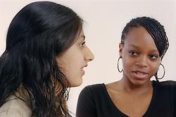Two teenage girls talking,