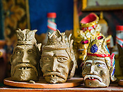 30 JULY 2016 - BANGKOK, THAILAND: Some of the clay figurines made by Lek, an artisan in the Pom Mahakan Fort slum. He said his family has been in the neighborhood for more than 40 years and can't move because if he moves his customers, mostly Thai and foreign tourists, won't be able to find him. Mahakan Fort was built in 1783 during the reign of Siamese King Rama I. It was one of 14 fortresses designed to protect Bangkok from foreign invaders. Only of two are remaining, the others have been torn down. A community developed in the fort when people started building houses and moving into it during the reign of King Rama V (1868-1910). The land was expropriated by Bangkok city government in 1992, but the people living in the fort refused to move. In 2004 courts ruled against the residents and said the city could take the land. Eviction notices have been posted in the community and people given until April 30 to leave, but most residents have refused to move. Residents think Bangkok city officials will start evictions around August 15, but there has not been any official word from the city.      PHOTO BY JACK KURTZ