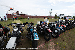 The Peter R Tregurtha giant Great Lakes freighter goes by as bikes line up for a panorama portrait in Aune Osborne Park in Sault Sainte Marie, the site of the official start of the Cross Country Chase motorcycle endurance run from Sault Sainte Marie, MI to Key West, FL. (for vintage bikes from 1930-1948). Thursday, September 5, 2019. Photography ©2019 Michael Lichter.