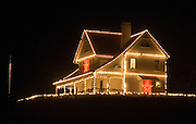 Holiday lights decorate the lighthouse keeper's house at Heceta Head Lighthouse, on the Oregon coast, USA.. Heceta Head State Park (which includes Devils Elbow State Park) is located in a cove at the mouth of Cape Creek.