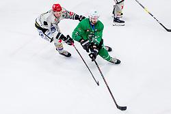 TadejCimzar of HDD Jesenice and Gregor Kobler of HK SZ Olimpija during Ice Hockey match between HK SZ Olimpija Ljubljana and HDD Jesenice in Round #24 of Alps Hockey League, on December 22, 2018 in Hala Tivoli, Ljubljana, Slovenia. Photo by Ziga Zupan / Sportida