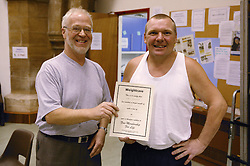 Man being congratulated for weight loss,