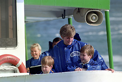 The Princess of Wales with Prince William and Prince Harry at the Niagara Falls, Canada.