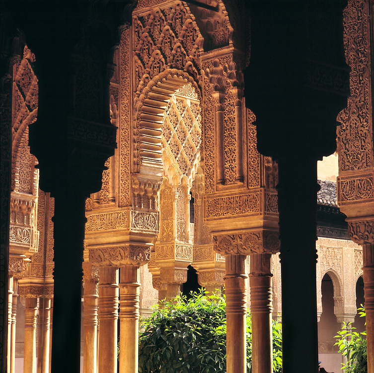 Shadow and light play in Court of the Lions, Alhambra Palace, Granada, Spain.