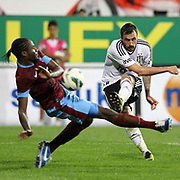 Besiktas's Hugo Miguel Pereira de Almeida (R) and Trabzonspor's Souleyman Bamba during their Turkish Superleague soccer derby match Besiktas between Trabzonspor at the Inonu Stadium at Dolmabahce in Istanbul Turkey on Sunday, 21 October 2012. Photo by Aykut AKICI/TURKPIX