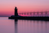 A color, long exposure shot of the South Haven pier and lighthouse just after sunset.