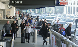 November 20, 2018 - Los Angeles, California, U.S - Holiday travelers arrive at Los Angeles International Airport on Tuesday, Nov. 20, 2018 in Los Angeles. The Automobile Club of Southern California says it's expecting this year's Thanksgiving holiday to be the busiest in Southern California since 2005, with 4.2 million residents expected to get away for the long weekend. (Credit Image: © Ringo Chiu/ZUMA Wire)