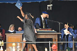 Excited Graduate Receiving Award at the Yale University Commencement 2009, President Levin and School Provost Salovey. Credit Photography: James R Anderson