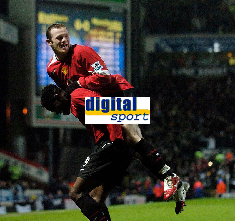 Photo: Jed Wee.<br /> Blackburn Rovers v Manchester United. Carling Cup. Semi Final, 1st Leg. 11/01/2006.<br /> <br /> Manchester United's Wayne Rooney (R) jumps on the shoulders of goalscorer Louis Saha in celebration.