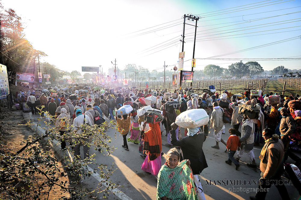 Pilgrims in Allahabad walk for hours to reach the the banks of Sangam, the confluence of the holy rivers Ganga, Yamuna and the mythical Saraswati.