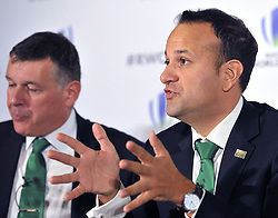 IRFU Chief Executive Philip Brown (left), listens as Taoiseach, Leo Varadkar speaks in support of the IRFU during the 2023 Rugby World Cup host candidates presentations at the Royal Garden Hotel in London, where they are bidding to host the event against France and South Africa.