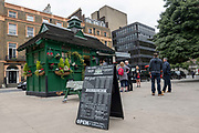 An a-board cafe menu outside a Cabmens Shelter cafe at Russell Square on the 16th September 2019 in London in the United Kingdom.