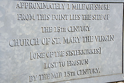 Plaque on seafront at Withernsea; East Yorkshire; England; commemorating former church; now lost to erosion