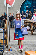 Dutch woman in traditional costume at Alkmaar Cheese Market,