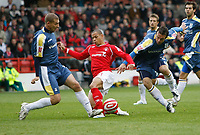 Photo: Richard Lane/Richard Lane Photography. Nottingham Forest v Cardiff City. Coca Cola Championship. 24/10/2008. Nathan Tyson (C) is fouled by Gabor Gyepes (L). Gavin Rae closes in (R)