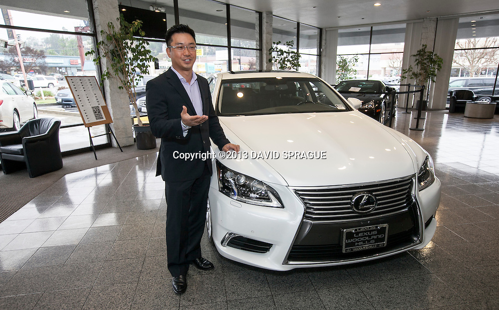 Michael Hong, Partner and General Manager, shows off the Lexus flagship sedan, the LS460 at Lexus of Woodland Hllls Jan. 25, 2013.Photo by David Sprague