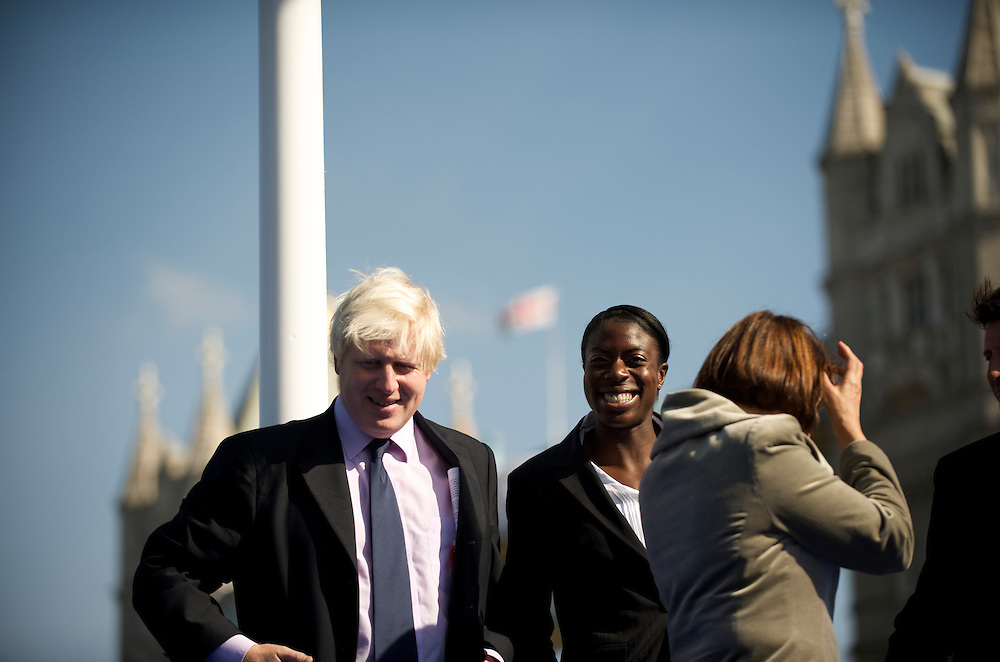 London.  September 26, 2008.  London Mayor Boris Johnson shares a laugh with  400m gold medal winner Christine Ohuruogu during the Olympic flag handover ceremony in Potter Fields Park for the 2012 games. Lord Sebastian Coe, Olympic Minister Tessa Jowell MP, 1948 Olympians, and 2012 hopefuls were also in attendance.  (Photo by Mark Bryan Makela)