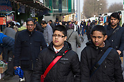 People from various ethnic backgrounds around the market on Whitechapel High Street in East London. This area in the Tower Hamlets is predominantly Muslim with just over 50% of Bangladeshi descent. This is known as a very Asian and multi cultural part of London's East End.