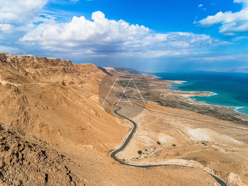 Aerial view of the surrounding desert area above the dead sea, blue water and clear blue sky, dead sea, Negev, Israel.