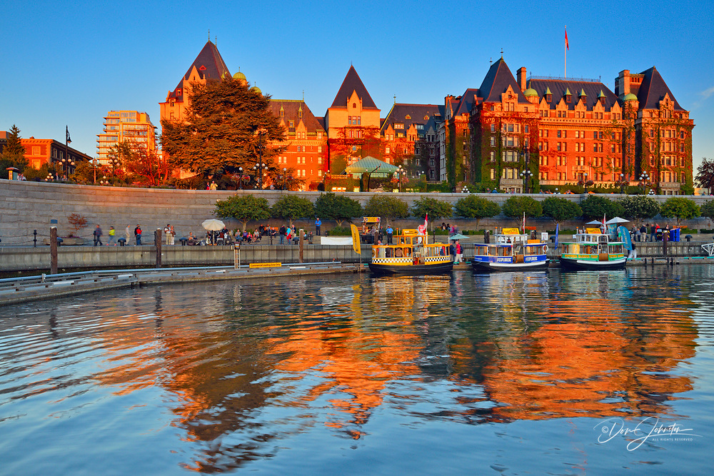 The Inner Harbour with the Empress Hotel reflected, Victoria , British Columbia, Canada