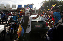 June 10, 2017 - Naguanagua, Carabobo, Venezuela - A member of the group of squires, greets with a clash of hands to a citizen who participate in the march we all are Palma Real, against the constituent and the president Nicol‡s Maduro, in Naguanagua, Carabobo state. Photo: Juan Carlos Hernandez (Credit Image: © Juan Carlos Hernandez via ZUMA Wire)