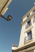 Low angle view of architectural detail with windows and balcony in Casablanca, Morocco
