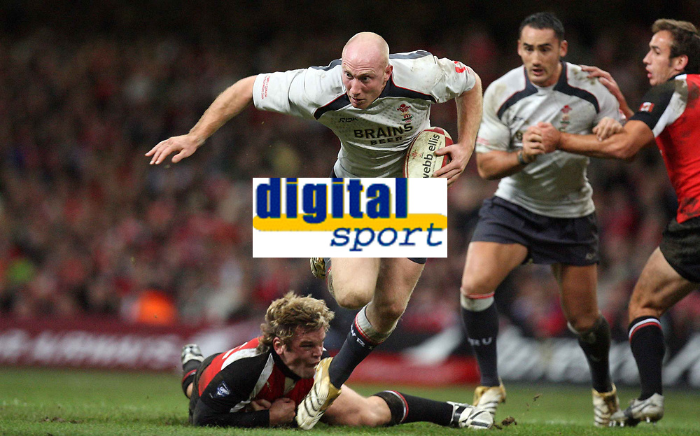 Photo: Rich Eaton.<br /> <br /> Wales v Canada. Invesco Perpetual Series. 17/11/2006. Tom Shanklin of Wales steps out of a tackle by David Spicer of Canada pictured lying on the floor
