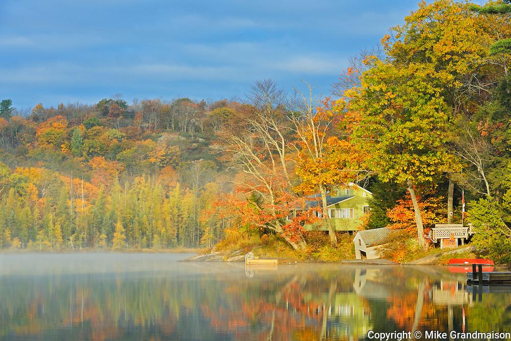 Cottage on Horseshoe Lake in morning fog<br /> Horseshoe Lake<br /> Ontario<br /> Canada