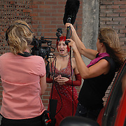 Zoe Balfour, center, of Oakland, California, is interviewed by a film crew in between dances while competing in the adult women's A standard division of the same-sex ballroom dancing competition during the 2007 Eurogames at the Waagnatie hangar in Antwerp, Belgium on July 14, 2007. ..Over 3,000 LGBT athletes competed in 11 sports, including same-sex dance, during the 11th annual European gay sporting event. Same-sex ballroom is a growing sports that has been happening in Europe for over two decades.