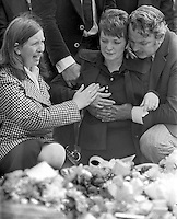 The mother of 3 year old Michelle O'Connor, is comforted by family members at her daughter's grave. Michelle died when a UDA/UFF booby trap bomb exploded when she was getting into the family car along with her father, John O'Connor, who received very serious injuries but survived. Michelle was being taken to nursery school. The incident took place on 13th June 1975. The funeral on 16th June 1975 was from the Holy Rosary Church on the Ormeau Road, Belfast, and was attended by hundreds of Protestants as well as Roman Catholics. No reason could be found for the attack other than sectarianism. 197506160497c<br /> <br /> Copyright Image from Victor Patterson, 54 Dorchester Park, Belfast, UK, BT9 6RJ<br /> <br /> t1: +44 28 9066 1296 (from Rep of Ireland 048 9066 1296)<br /> t2: +44 28 9002 2446 (from Rep of Ireland 048 9002 2446)<br /> m: +44 7802 353836<br /> <br /> victorpattersonbelfast@gmail.com<br /> victorpatterson@me.com<br /> <br /> www.victorpatterson.com<br /> <br /> Please see my Terms and Conditions of Use at victorpatterson.com. It is IMPORTANT that you familiarise yourself with them.<br /> <br /> Images used on the Internet incur an additional cost and must be visibly watermarked i.e. ©Victor Patterson within the body of the image and copyright metadata must not be deleted. Images used on the Internet have a size restriction of 4kbs and are chargeable at rates available at victorpatterson.com.<br /> <br /> This image is available only for the use of the download recipient i.e. television station, newspaper, magazine, book publisher, etc, and must not be passed on to any third party. It is also downloaded on condition that each and every usage is notified within 7 days to victorpatterson@me.com<br /> <br /> The right of Victor Patterson (or the named photographer) to be identified as the author is asserted in accordance with The Copyright Designs And Patents Act (1988). All moral rights are asserted.