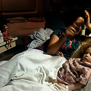 Holly Larue Frizzelle, 2, and her mother Leilani Frizzelle sit in Larue's room at UNC Children's Hospital in December of 2012On December 27, 2012 two year old Holly Larue Frizzelle was diagnosed with Acute Lymphoblastic Leukemia. What began as a stomach ache and visit to her regular pediatrician led to a hospital admission, transport to the University of North Carolina Children's Hospital, and more than two years of treatment.