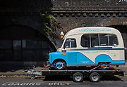 A Bedford ice cream van sits on a trailer in a Loading Only bay under railway arches in Camberwell, on 5th July 2017, in London, England.