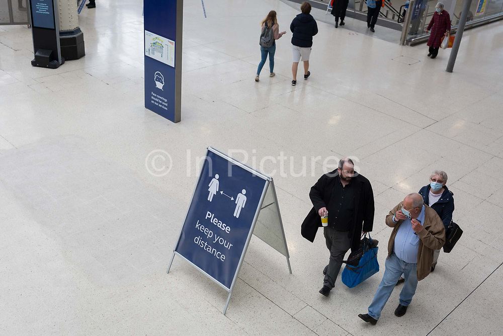 With the UKs Coronavirus pandemic lockdown easing with preparations going ahead for the opening of more public transport and services plus shops, another 151 have died from Covid-19 bringing the total in the last 24hrs to 41,279. Rail passengers make their way through the concourse Waterloo Station while being asked to wear face coverings and to stay apart which is in line with government requirements for all users of public trransport starting next Monday 15th June, on 11th June 2020, in London, England.